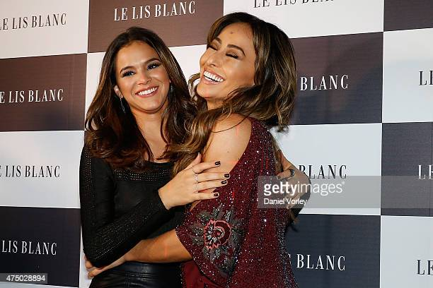 Bruna Marquezine and Sabrina Sato attend Le Lis Blanc Winter Collection Cocktail at Le Lis Blanc store on May 28 2015 in Sao Paulo Brazil Ê