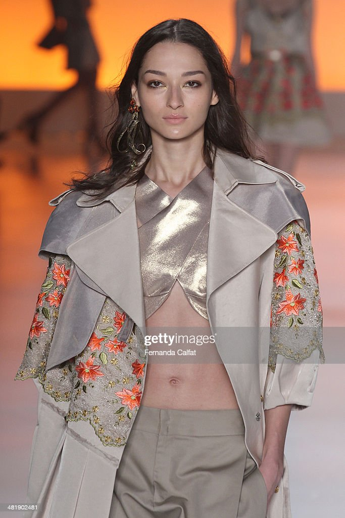 Bruna Tenorio walks the runway at Triton show during Sao Paulo Fashion Week Summer 2014/2015 at Parque Candido Portinari on April 1 2014 in Sao Paulo...