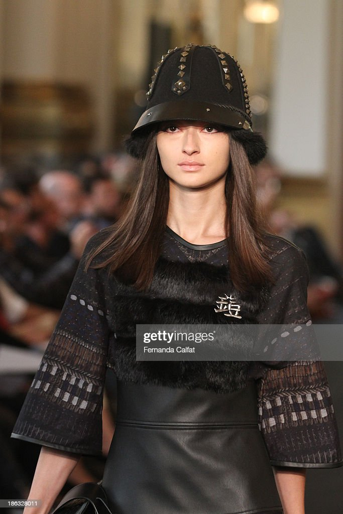 <a gi-track='captionPersonalityLinkClicked' href=/galleries/search?phrase=Bruna+Tenorio&family=editorial&specificpeople=4341430 ng-click='$event.stopPropagation()'>Bruna Tenorio</a> walks the runway during Ellus show at Sao Paulo Fashion Week Winter 2014 on October 30, 2013 in Sao Paulo, Brazil.