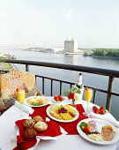 Brunch laid out on table, hotel balcony, elevated view
