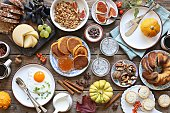 Brunch. Thanksgiving family breakfast or brunch set served on rustic wooden table. Overhead view, copy space