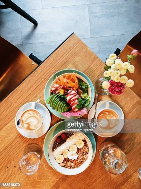 Brunch with quinoa bowl, acai bowl and coffee, high angle view