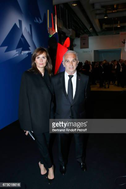 Brune de Margerie and Alain Terzian pose in front the works of JeanPaul Goude during the 'Societe des Amis du Musee d'Art Moderne du Centre Pompidou'...