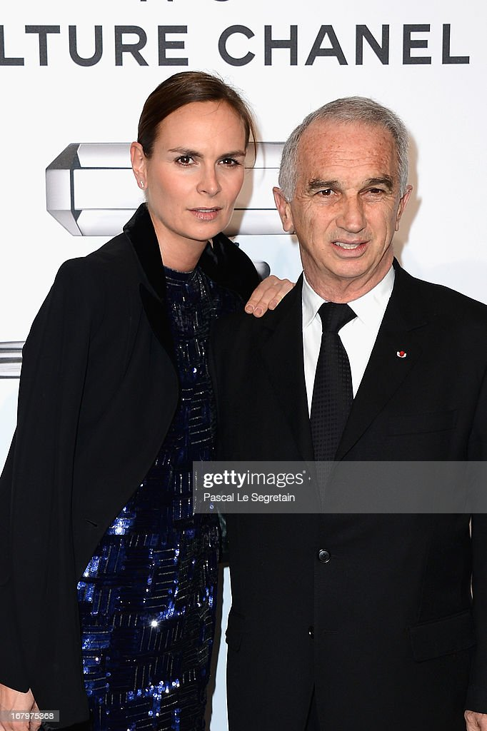 Brune de Marjorie and Alain Terzian pose during a photocall for 'N°5 Culture Chanel' exhibition at Palais De Tokyo on May 3, 2013 in Paris, France.