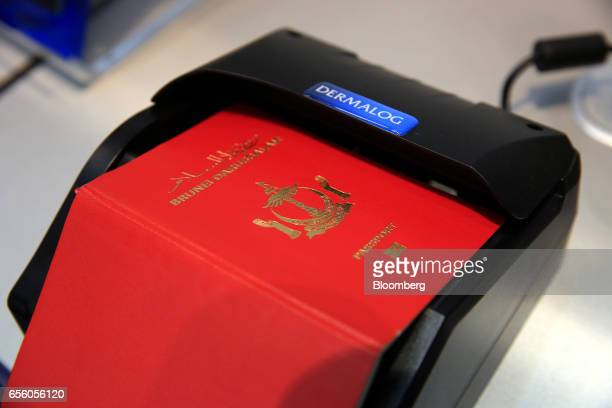 A Brunei passport sits on a document scanning device at the Dermalog Identification Systems GmbH pavilion at the CeBIT 2017 tech fair in Hannover...