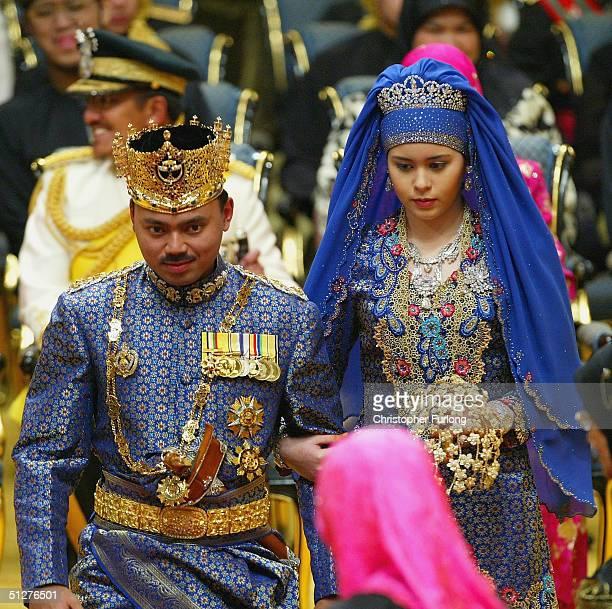 Bruneian Crown Prince AlMuhtadee Billah Bolkiah and his bride commoner Sarah Salleh are seen during their wedding at the Balai Singgahsana Indera...