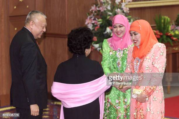 Brunei's Queen Mariam Abdul Aziz and Queen Saleha Mohamad Alam greet Hong Kong Chief Executive Tung CheeHwa and his wife ahead of the gala dinner for...