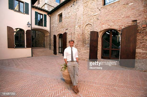 Brunello Cucinelli chairman and chief executive officer of Brunello Cucinelli SpA poses for a photograph outside the company's offices in Solomeo...