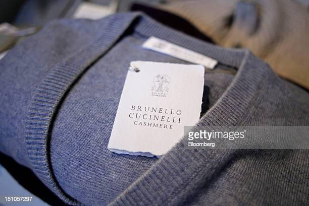 A Brunello Cucinelli SpA clothes label sits inside a cashmere garment displayed for sale at the company's store in Solomeo near Perugia Italy on...