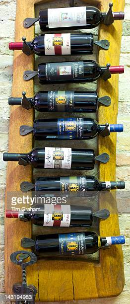 Brunello di Montalcino old vintage bottles of red wine at wine estate of Palazzo near Montalcino in Val D'Orcia Tuscany Italy