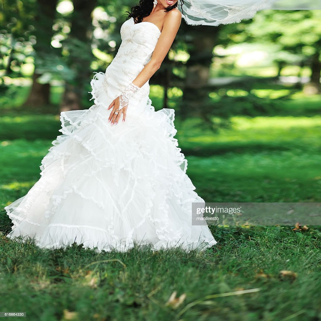 brunette bride wearing white dress : Stock Photo