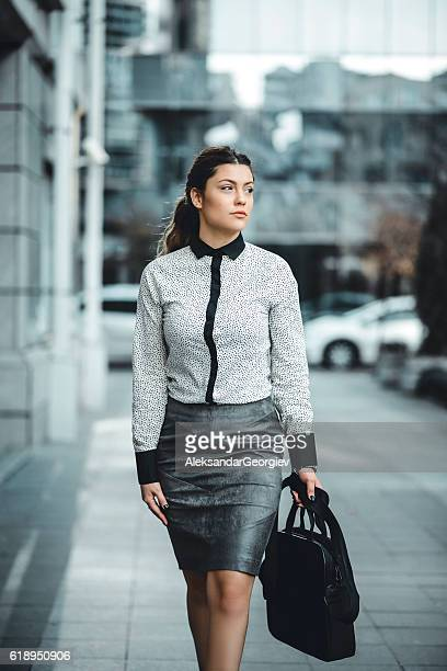 Brunette Businesswoman with LapTop Bag Walking Outdoor on Street