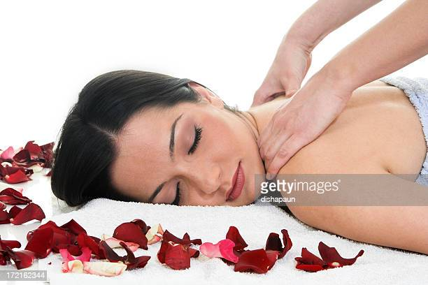Brunette getting a back massage in the spa salon