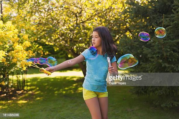 brunette girl making big bubbles