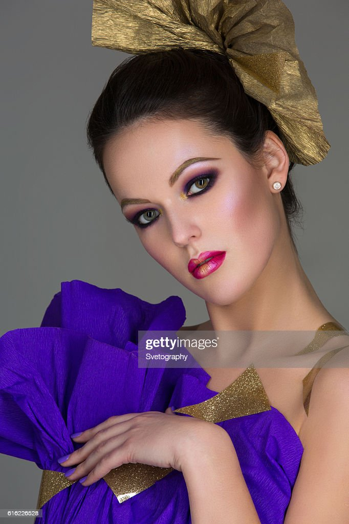 Brunette girl with purple make-up : Stock Photo