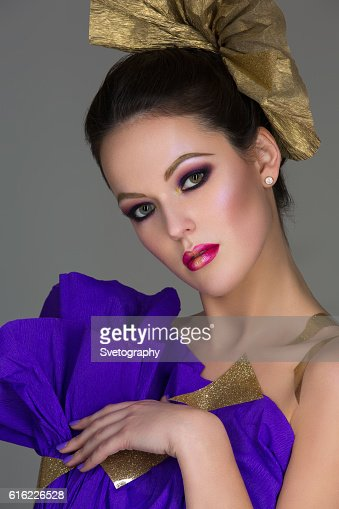 Brunette girl with purple make-up : Foto stock