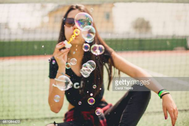 brunette teenager having fun with bubbles