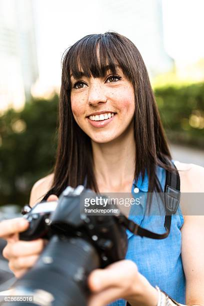 brunette tourist with a camera in Montreal - Canada