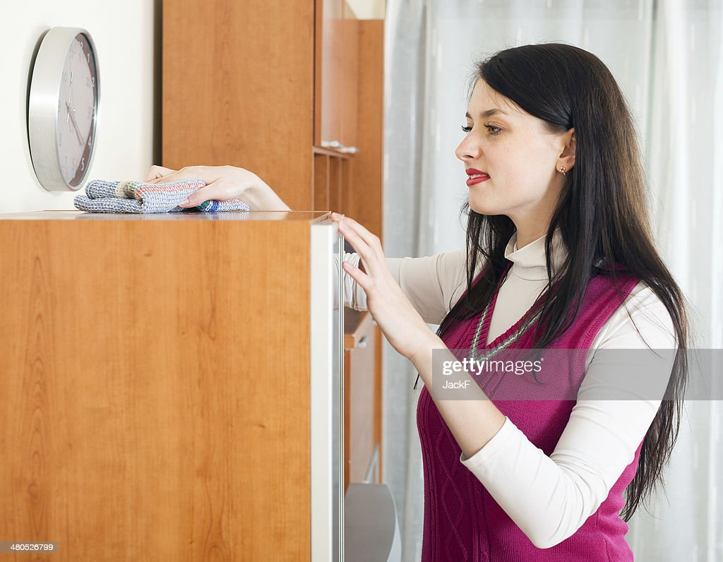 brunette woman cleaning  furiture : Stock Photo