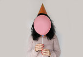 Brunette woman with balloon as face