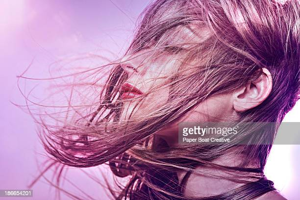 brunette woman with hair sweeping over her face
