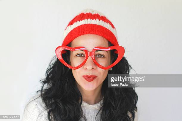 Brunette woman with red glasses and red cap