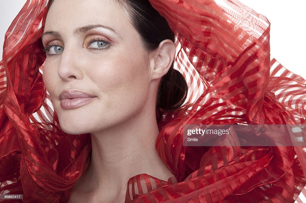 Brunette woman with red silk around her head : Stock Photo