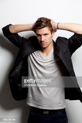 Young Man Wearing Suit Jacket And Shirt Stock Photo | Getty Images