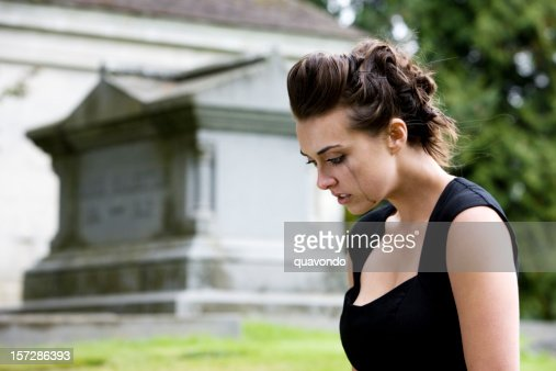Brunette Young Woman Mourning at Graveyard, Copy Space