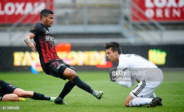 Bruninho of FC Midtjylland and Goalkeeper Jesper Hansen of Lyngby Boldklub compete for the ball during the Danish Alka Superliga match between Lyngby...