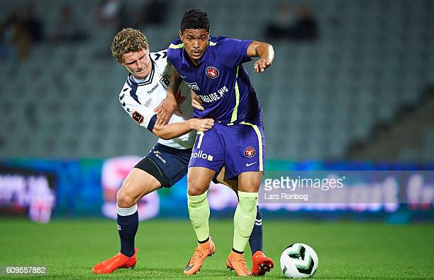 Bruninho of FC Midtjylland and Jens Stage of AGF Aarhus compete for the ball during the Danish Alka Superliga match between AGF Aarhus and FC...