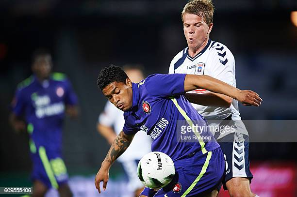 Bruninho of FC Midtjylland and Jesper Juelsgard of AGF Aarhus compete for the ball during the Danish Alka Superliga match between AGF Aarhus and FC...