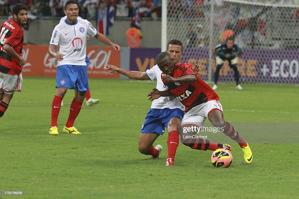 Bruninho of Flamengo fights for the ball with Rafael Miranda of Bahia during a match between Flamengo and Bahia as part of the Brazilian Serie A Championship at Arena Fonte Nova Stadium on July 31, 2013 in Salvador, Brasil.