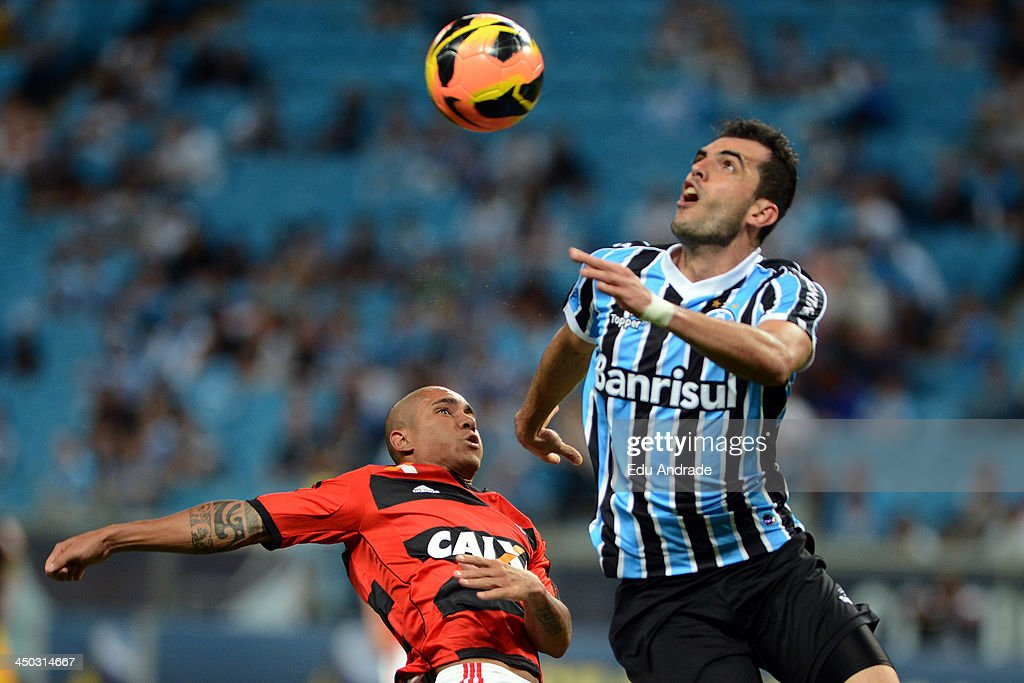 Bruninho of Flamengo fights for the ball with Rhodolfo of Gremio during the match between Gremio and Flamengo for the Brazilian Series A 2013 at Arena Gremio Stadium on November 17, 2013, in Porto Alegre, Brazil.
