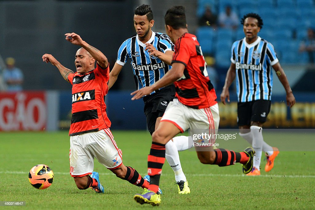 Bruninho (L) of Flamengo runs for the ball during the match between Gremio and Flamengo for the Brazilian Series A 2013 at Arena Gremio Stadium on November 17, 2013, in Porto Alegre, Brazil.
