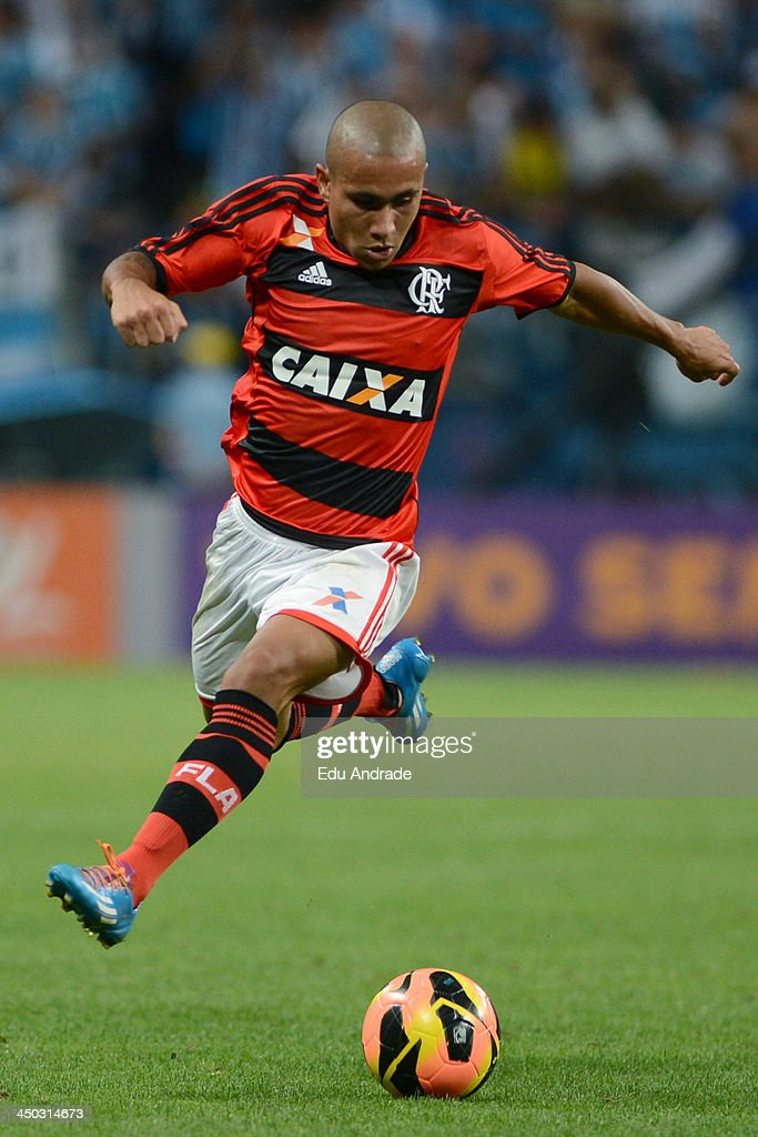 Bruninho of Flamengo runs for the ball during the match between Gremio and Flamengo for the Brazilian Series A 2013 at Arena Gremio Stadium on November 17, 2013, in Porto Alegre, Brazil.
