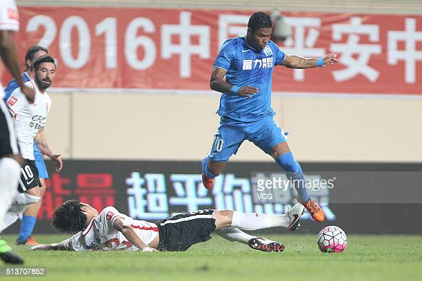 Bruninho of Guangzhou RF drives the ball during the Chinese Football Association Super League match between Guangzhou RF and Hebei China Fortune at...