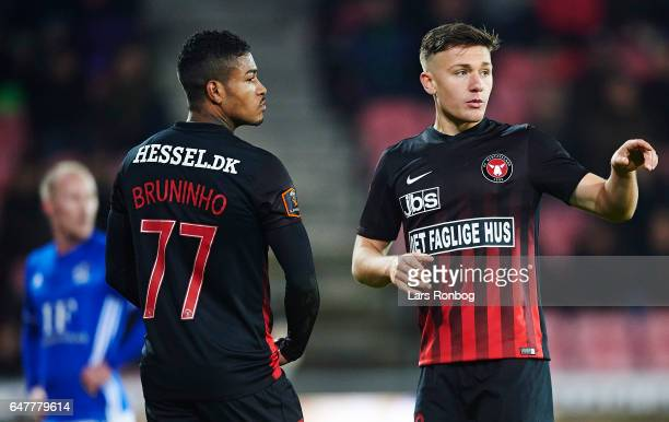 Bruninho speaks to Mikkel Duelund of FC Midtjylland during the Danish Alka Superliga match between FC Midtjylland and Lyngby BK at MCH Arena on March...