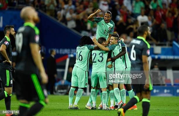 Bruno Alves and Portugal players celebrate their team's second goal scored by Nani during the UEFA EURO 2016 semi final match between Portugal and...