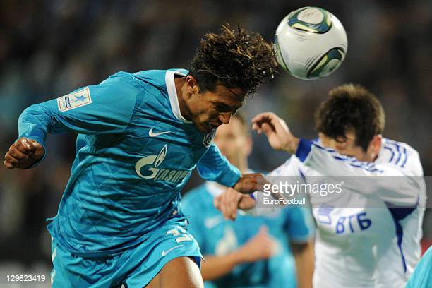 Bruno Alves of FC Zenit St Petersburg heads the ball clear from Marko Lomic of FC Dinamo Moskva during the Russian Premier League match between FC...