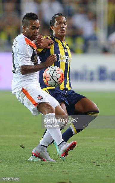 Bruno Alves of Fenerbahce is in action with Alex Teixeira of Shaktar Donetsk during UEFA Champions League Third Qualifying Round 1st Leg match...