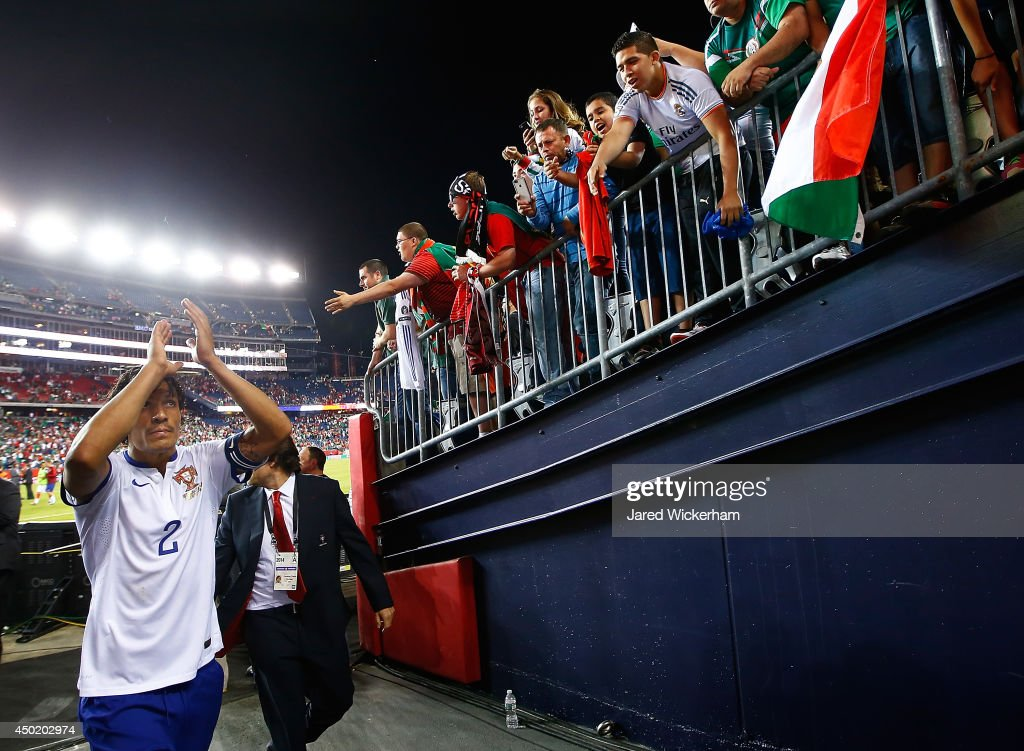 <a gi-track='captionPersonalityLinkClicked' href=/galleries/search?phrase=Bruno+Alves&family=editorial&specificpeople=2149132 ng-click='$event.stopPropagation()'>Bruno Alves</a> #2 of Portugal acknowledges the fans while exiting the stadium after scoring the game-winning goal in the final seconds of extra time in the second half against Mexico during the international friendly match at Gillette Stadium on June 6, 2014 in Foxboro, Massachusetts.