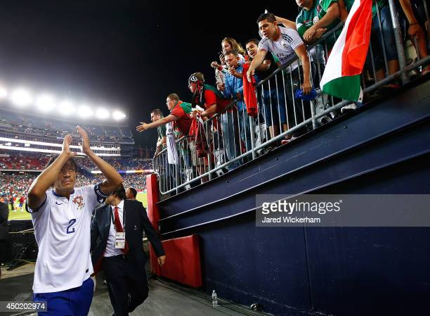Bruno Alves of Portugal acknowledges the fans while exiting the stadium after scoring the gamewinning goal in the final seconds of extra time in the...