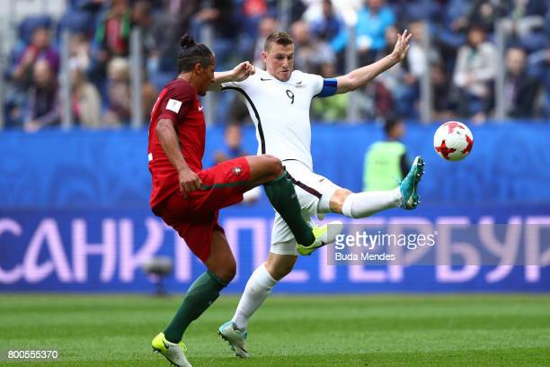Bruno Alves of Portugal and Chris Wood of New Zealand battle for possession during the FIFA Confederations Cup Russia 2017 Group A match between New...