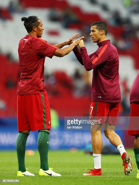 Bruno Alves of Portugal and Cristiano Ronaldo of Portugal embrace whole warming up prior to the FIFA Confederations Cup Russia 2017 SemiFinal between...