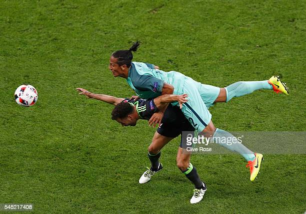 Bruno Alves of Portugal and Hal RobsonKanu of Wales compete for the ball during the UEFA EURO 2016 semi final match between Portugal and Wales at...