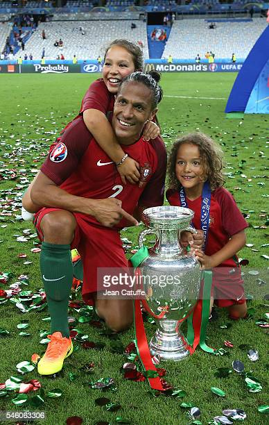 Bruno Alves of Portugal and his children pose with the trophy following the UEFA Euro 2016 final match between Portugal and France at Stade de France...