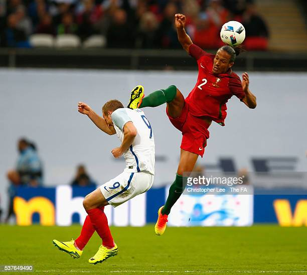Bruno Alves of Portugal challenges Harry Kane of England leading to his sending off during the International Friendly match between England and...