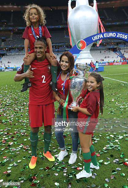 Bruno Alves of Portugal his wife Rute Alves and their children pose with the trophy following the UEFA Euro 2016 final match between Portugal and...