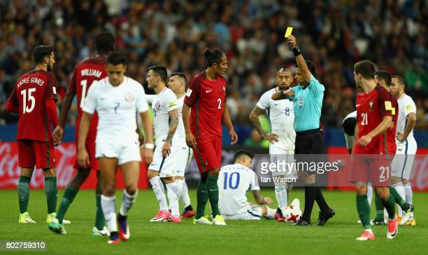 Bruno Alves of Portugal is shown a yellow card by Referee Alireza Faghani during the FIFA Confederations Cup Russia 2017 SemiFinal between Portugal...